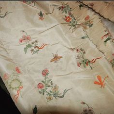 This beautiful hand-painted silk gown is from The Peterborough Museum. The charming design includes posies tied with ribbon and insects including beetles and dragonflies. To see another 18th c. painted silk gown (recently discovered) go to the BBC Antiques Road Show Facebook page where there is a video.