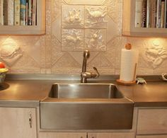 Countertop Enhancements - Frigo Design Integrated farm sink into stainless countertop