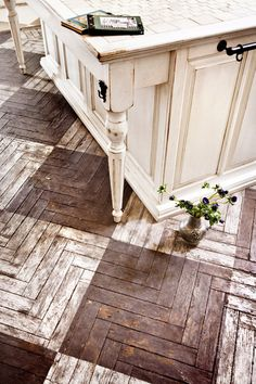 Beautiful tile patterned wood floor.. Can you just imagine how much of a pain this would be to clean (unless it was sealed). Seen some not sealed!