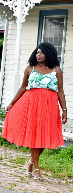 Cute plus size coral pleated skirt with a #palmprint top. Green+ coral +nude. #style
