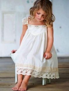 flower girl dress french vanilla baby doll dress Cotton party dress with a divine lace crossover wingback. Bodice trimmed with a delicate rose lace with some sequin scallops. Hem trimmed with contrasting laces in the same colour palette. Fashion Kids, Little Girl Fashion, Little Girl Dresses, Girls Dresses, Flower Girls, Flower Girl Dresses, Lace Dresses, Bride Dresses, Wedding Dresses