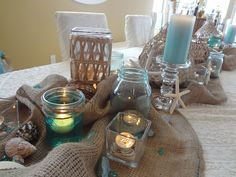 Beach themed bridal shower ideas needed beach theme centerpieces beach themed centerpiece burlap table runner with pretty blue candlesis site did not lead to anything else with beach theme but i like this table junglespirit Image collections