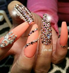 Orange rhinestone nails @parissnails