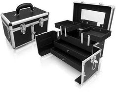 Seya Black Studio Case by Seya. $59.95. 1 Center latch for Secure closure, 2 top latches. 2 removable tray drawers. 2 extendable trays. Elegant black exterior. Black matte interior. Stylish, sleek, and perfect for the person on the go. This makeup train case is expertly designed to organize and transport makeup brushes, makeup tools and other accessories. The hard outer shell and over locking snap-closure, ensures your beauty essentials travel securely.