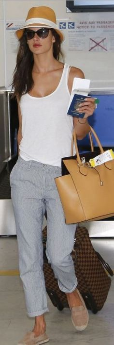Alessandra Ambrosio: Purse – Michael Kors  Suitcase – Louis Vuitton  Pants – Big Star
