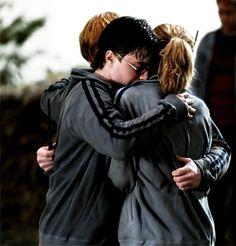 Harry/Ron/Hermione hug. Trio love.