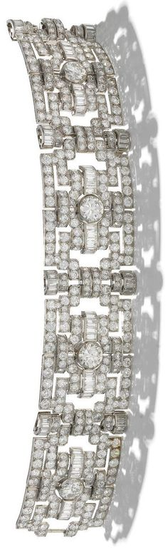 An Art Deco diamond bracelet, circa 1935. The wide articulated strap composed of four openwork geometric plaques, set throughout with old brilliant, brilliant, single and baguette-cut diamonds, each with a principal diamond to the centre, diamonds approximately 32.55 carats total, French assay mark. #ArtDeco