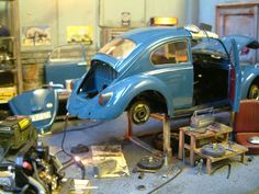 A 1960's Garage Diorama - looks familiar as I once had a VW bug decades ago.