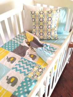 I would love something like the Is for baby. something personalized in the nursery colors. Elephant Baby Crib Quilt in Aqua grey and by AlphabetMonkey