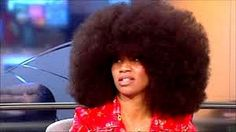She holds the record for the women with the largest Afro!   Love it!