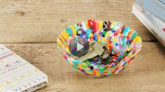 Grab a handful of meltable plastic beads and you've got the key supply for a colorful bowl. Watch how we used a household dish to form it!/