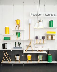Pedersen and Lennard, in Cape Town with bright bucket stools