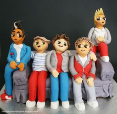 One Direction Teen Birthday Cake, all the 1D boys sitting on the couch like they do in concert, cartoon figures made from fondant :)