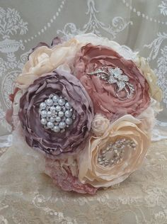 Beautiful Handmade Fabric and Brooch Wedding Bouquet. £150.00, via Etsy.