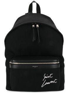 Saint Laurent Black Logo Embroidered Backpack In 1077 Blk/mu Backpack Outfit, Fashion Backpack, Louis Vuitton Luggage, Designer Backpacks, Luxury Backpacks, Designer Handbags, Luxury Purses, Black Leather Backpack, Leather