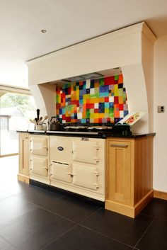 A Patchwork splashback made as one large panel to fit perfectly into the alcove behind the Aga.