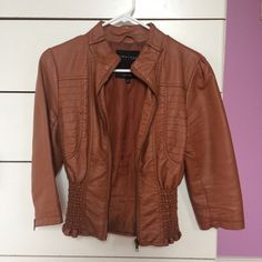 Faux Brown Leather Jacket  w/cropped sleeves Faux Leather jacket with cropped sleeves. It has an elastic cropped waist so that when it is zipped up, it fits snugly around your torso while the top is more loose. It has cropped 3/4 sleeves, great for fall and spring weather. Size M, fits like a small. Price is negotiable, make me an offer  mandee Jackets & Coats