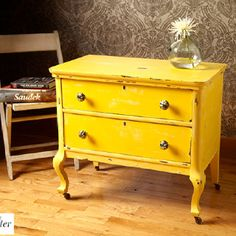 Yellow bedroom night stand. I'd refinish it it a creamy white or a pretty turquoise.