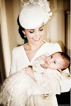Official Christening Photo - Will & Kate attended Princess Charlotte's christening with Prince George. Members of both families were in attendance. Kate was wearing a bespoke Alexander McQueen coat dress, a Jane Taylor hat & 'Pointy' heels by Russell and Bromley. - 7/5/2015