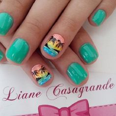 Cute looking Palm Tree Nail Art design. The nails are painted with matte blue green polish. While there is a single nail for each hand that is painted in multi color. These nails also have the palm tree designs and they look beautiful.