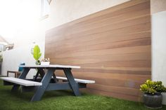 Custom wood accent wall and backyard picnic bench in Orange County California  http://www.trulandscape.com/modern-backyard-remodel/