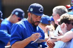 Mar 1, 2017; Dunedin, FL, USA; Toronto Blue Jays infielder Devon Travis (29) signs autographs before the spring training game against the Detroit Tigers at Florida Auto Exchange Stadium. Mandatory Credit: Jonathan Dyer-USA TODAY Sports