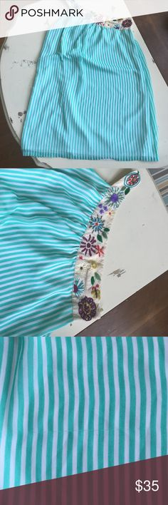 Judith March dress size large Cute cute cute teal stripped dress with floral one shoulder strap. Size large. A couple little pulls in the dress but I showed a pic of it and it's not noticeable while wearing it. Judith March Dresses Midi