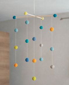 Beautiful felt ball mobile in beautiful bright colors. To hang over the crib or changing table. This mobile has a suspension with felt balls. Watch