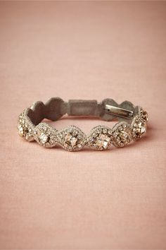 """Cabrini Bracelet Handmade by Deepa Gurnani. Box clasp. 7.5""""L, 0.5""""W. Glass crystals, Nappa leather backing, silver plated brass. Imported."""