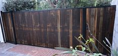 Reclaimed wood Fence. Automatic Driveway Gate Installation