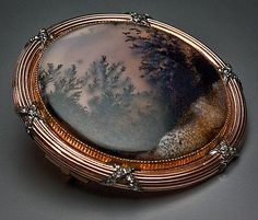An antique Faberge pink gold (14K-583) and moss agate brooch, by head workmaster Henrik Wigstrom. Diameter 1 1/2 in. (3,7 cm) The moss agate plaque
