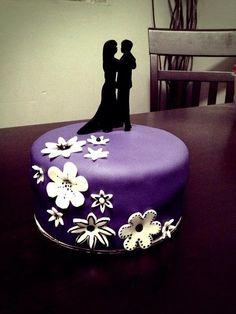 A small wedding cake Www.facebook.com/fondantcustomcakes