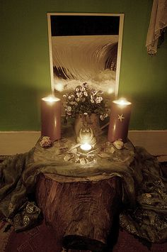 Altar to Freya - the norse goddess of love and beauty. The altar itself is a tree stump that I lugged home from the riverside one day, it has served for the basis of many different altars over the years and is well worn and loved. Pagan Altar, Wiccan, Magick, Witchcraft, Norse Goddess Of Love, Home Altar, Asatru, Meditation Space, Book Of Shadows