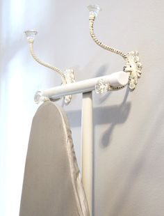 Sewing room tip: use decorative hooks to store ironing board when not in use. Organizing Ideas, Sewing Room Organization, Organization Hacks, Sewing Office Room, Sewing Rooms, Sewing Room Decor, Ironing Board Storage, Ironing Board Hanger, Ironing Board Covers