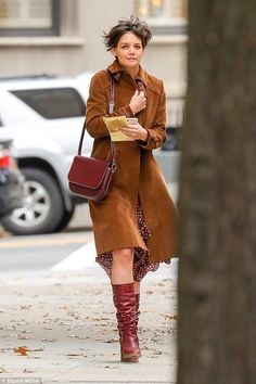 Doing her own thing! Make-up free Katie Holmes was a little windswept as she enjoyed a sol...