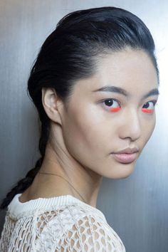 """Backstage at Peter Som, makeup artist Yadim made it clear that there are no rules when it comes to which products you use where. He swiped Maybelline Color Sensational Vivids Lipstick in Vibrant Mandarin across the lower lash line in place of eyeliner and contoured cheekbones with taupe eyeshadow. """"Bronzer tends to be too orange-y and warm,"""" he said. """"You want a nice even-toned brownish gray."""""""