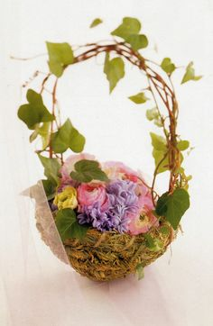I like this idea for the flower girl's basket...cover it with moss and have some greenery on the handle maybe?  http://diyweddingplanner.hubpages.com/hub/Woodlands-Theme-Wedding-A-Beautiful-And-Inexpensive-Wedding-Theme
