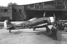This is probaly another Fw 190 required by the pilots of the 354th Fighter Group Has later war era outline cross on fuselage and VERY late war Nose band. The Fuselage MG's lookto be 13mm with the larger bulges so I'd guess it's and A-8 or A-9 or a F-8/9 with the earlier canopy. (plus given the US truck, it looks captured