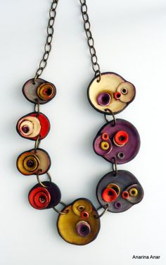 Polymer clay necklace.  - Unique organic shape.  - Total length: approx. 21.5 cm.  - The ring through which the T-bar is secured, is on the right
