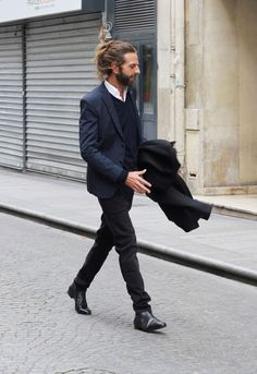 Classic cut suit given 'edge' by hipster hair and beard ... nice combo (not many could pull it off!)