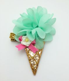 Mint glitter ice cream cone hair clip or headband by teaandtoastx on Etsy https://www.etsy.com/listing/192610063/mint-glitter-ice-cream-cone-hair-clip-or