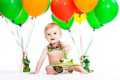 "My favorite picture from cake smash.  He has a very hungry caterpillar cake; bowtie & diaper cover with the Eric Carl signature ""dots"" and balloons.  http://www.etsy.com/shop/freshsqueezedbaby"