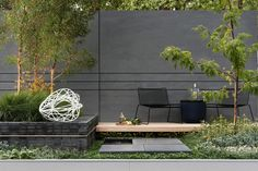 Grey and muted but very cool contemporary garden | adam christopher flower pots