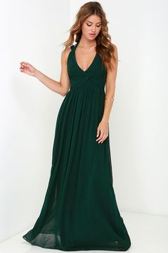 The Strike a Minerva Dark Green Maxi Dress is bound to hit a high note and win its way into your good graces in no time at all! This chiffon dress features a highly pintucked triangle bodice, with double shoulder straps emerging from the peaks, and wrapping above your shoulders and behind your neck with a chic two-button closure. The skirt gathers at the waist and reaches down to an elegant maxi length. Hidden back zipper/clasp closure. Fully lined. 100% Polyester. Dry Clean Only.
