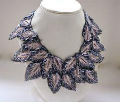 The Magnolia Botanical Necklace- Slate & Blush Petals. $500.00, via Etsy. (0thers 400)