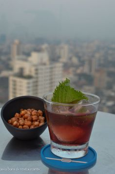Foreign Trader- Johnnie Walker Gold Reserve, port and junmai sake. Hand-carved ice and shiso leaf.   http://www.asia-bars.com/2014/03/octave-rooftop-lounge-bar-bangkok-marriott-hotel-sukhumvit/