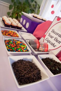 Cupcake Bar, you could do these and then just get a really pretty smash cake for Kaleigh so she has something to blow her candle out on and for pictures. We could make the cupcakes ourselves too so we have a variety of whatever you want, we could even make pink and purple cupcakes!