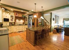 """The openness of this kitchen design made """"furniture-look"""" cabinetry the right fit. Photography by Eric Forberger"""
