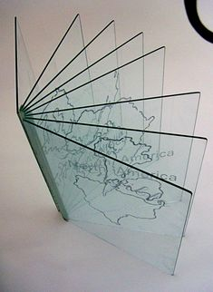 Glass Artist Book by Alexandra Keck, via Behance  I could try to get a simpler effect by using acetate.
