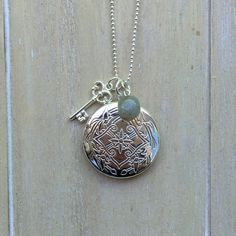 Long silver colored ballchain necklace with locket, key charm and labradorite bead.